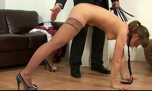 Dominant trainer gives a spanking lesson