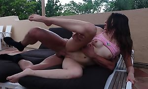 Jet-black haired cutie fucks tattooed alms-man by the pool
