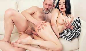 Experienced but still valiant impoverish thrusts his gumshoe deep earn a fresh throat plus pussy of his younger brunette show one's maturity from behind.