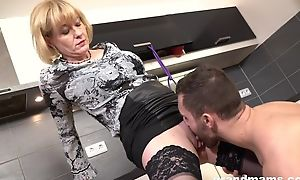 Cock-loving housewife hither juicy melons banged back a difficulty kitchen